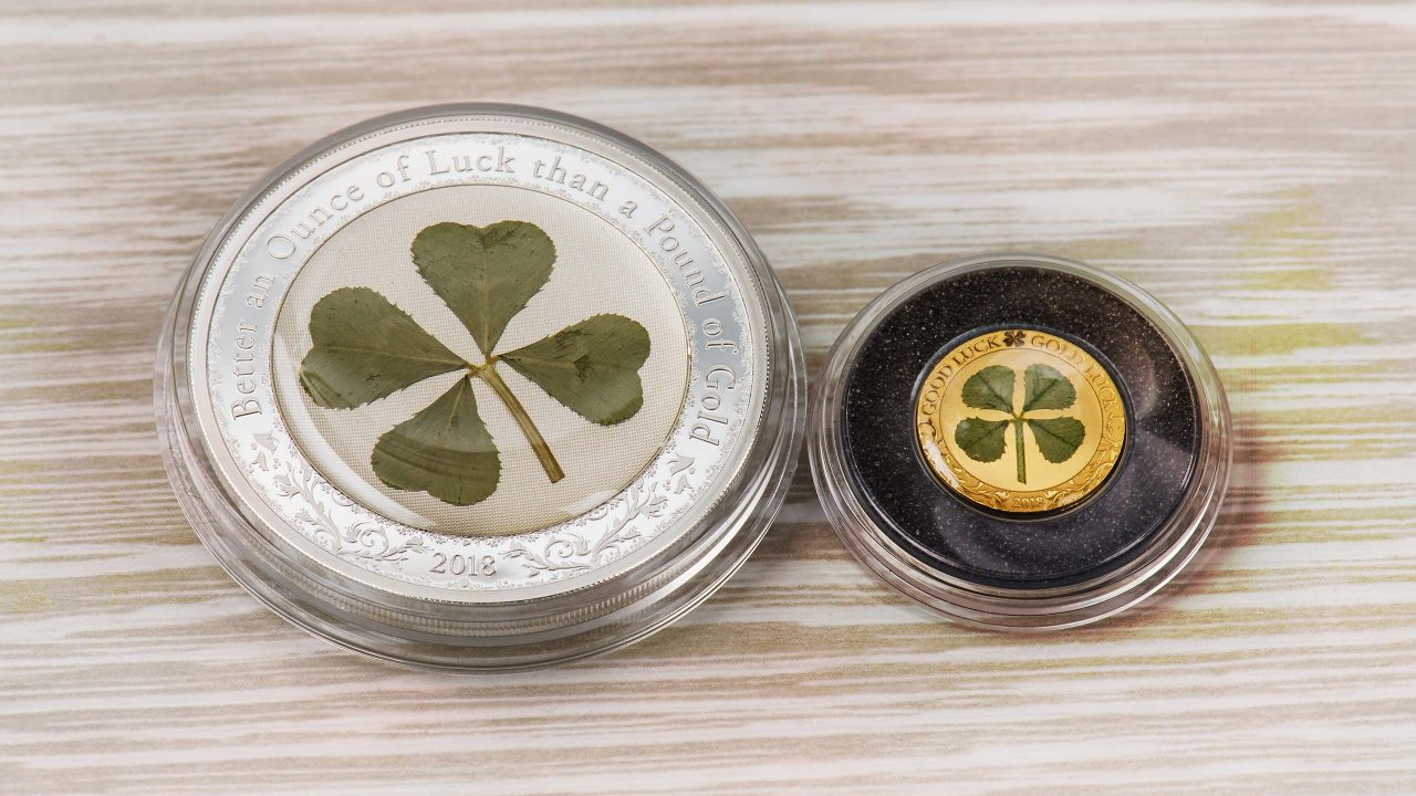 Silver coin with real four leaf clover for good luck charm