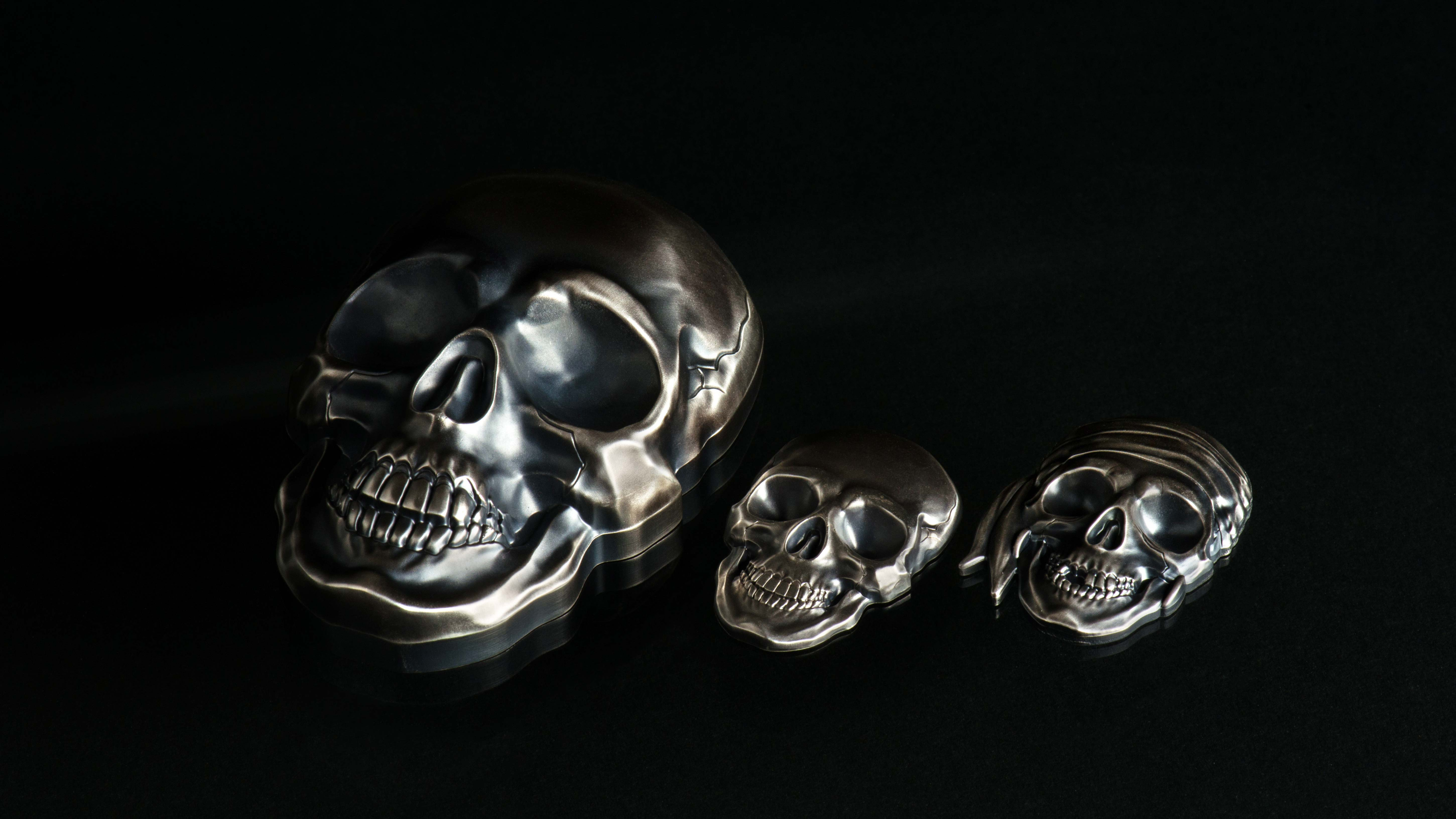 Silver coins shaped like skulls with smartminting high relief